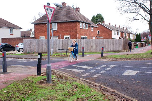 Raised crossings at side road crossings